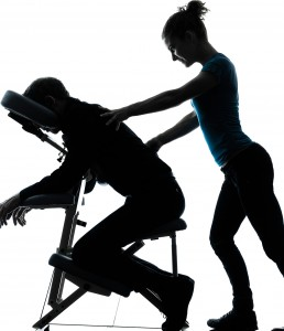 one man and woman performing chair back massage in silhouette studio on white background
